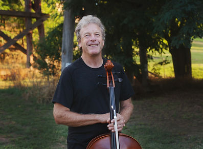 David Pereira posing with cello