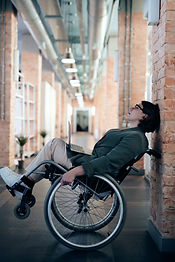 woman-sitting-on-wheelchair-while-leanin