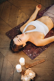 woman-relaxing-in-yoga-mat-3822647.jpg