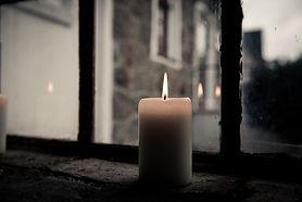 pillar-candle-near-clear-glass-window-14