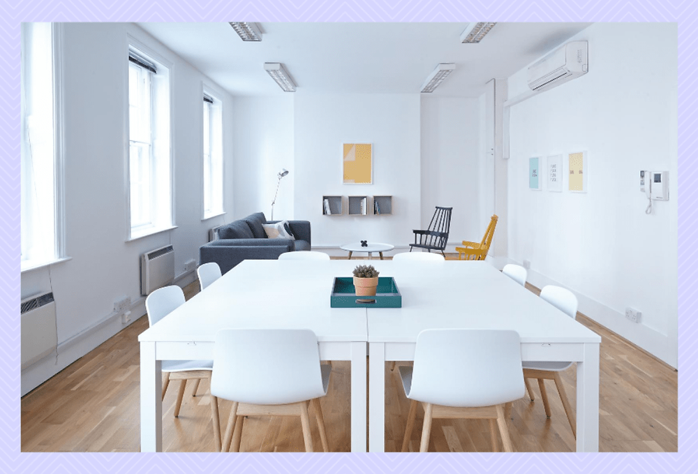 Clean Office Space | Valuing your Employees | A Lifestyle Blog by Andi | Philippines | Clean and tidy office setup. White walls, two large tables, and eight chairs