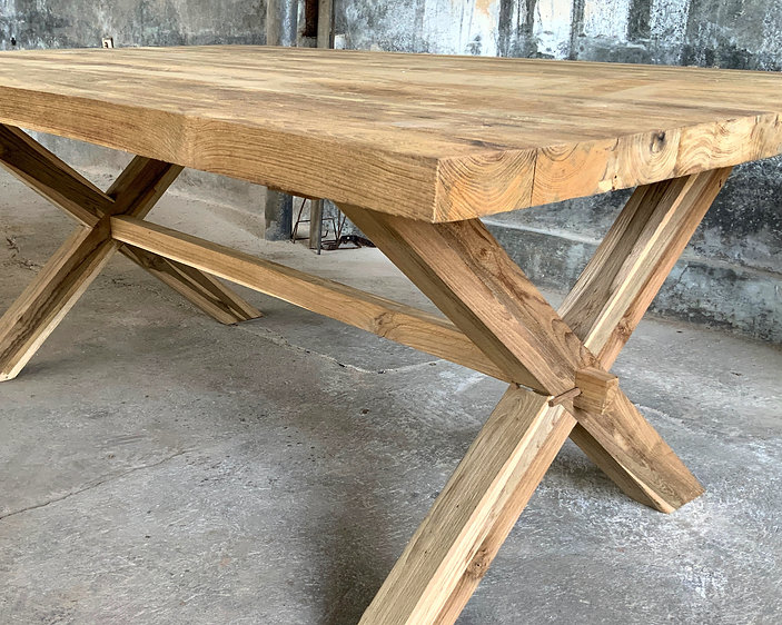 Recycled teak dining table with crossed legs