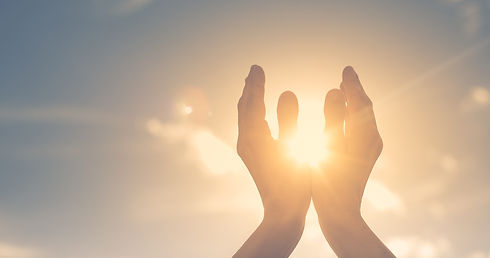 Woman hands holding the sun at dawn. Fre