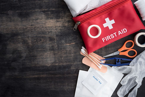 First aid medical kit on wood background