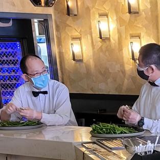 Servers Peeling String Beans