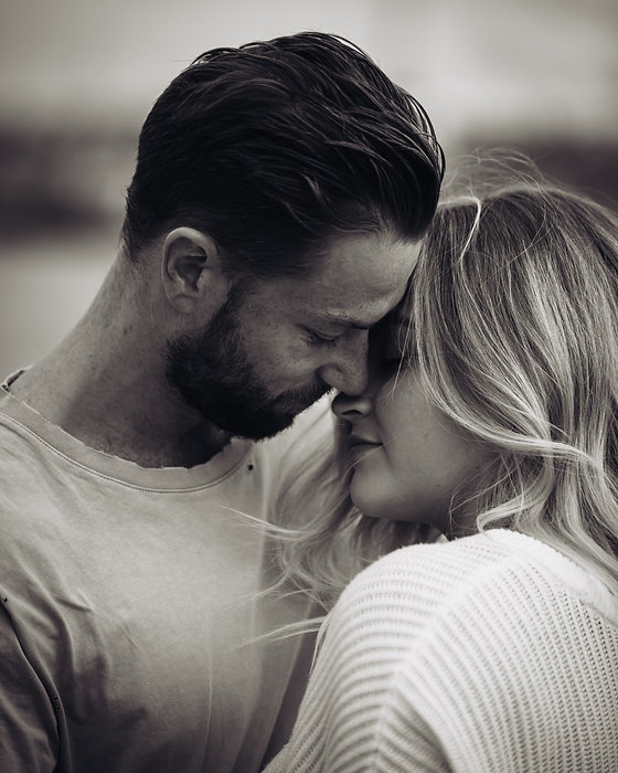 Black and white close up of couple about to kiss