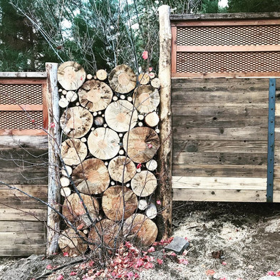 Hot tub wall - metal, stone, and logs