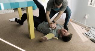 Eddie (Austin Fuerst) stabs Thoreau (Yaniv Bercovitz) with imaginary glucagon
