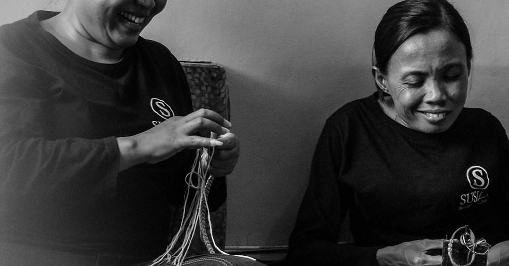 SUSILA artisans in Bali laughing while making handmade bracelets