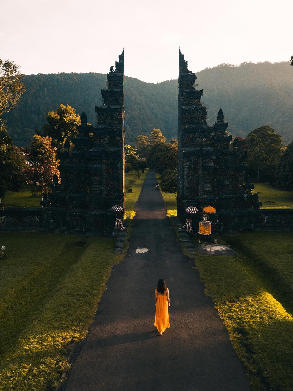 Girl in yellow dress standing in front of Handara Iconic Gate
