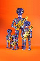 Wooden mayan handicraft skeleton with guitar