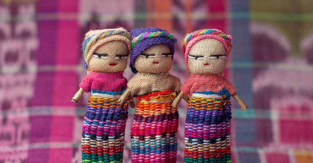 3 handmade worry dolls up close