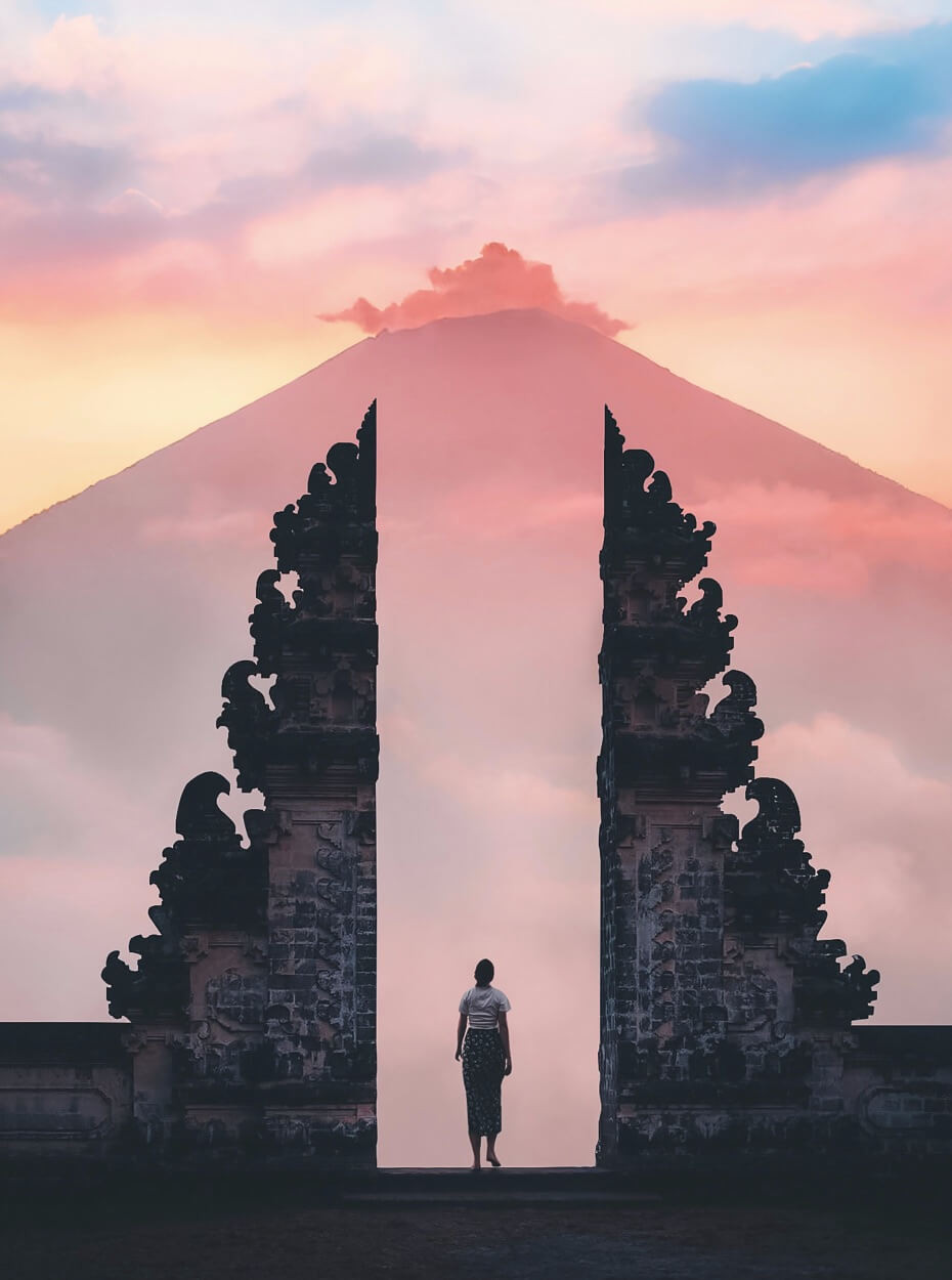 Pura Lempuyang iconic gateway temple with Mt. Agung and a pink sky in the background