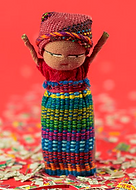 Handmade worry doll standing by itself
