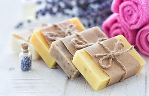 Lavender soap and salt on rustic wooden