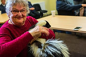 WNDA-Groups-Deaf club attendee enjoying a visit from a local wildlife sanctuary - Holding a skunk!