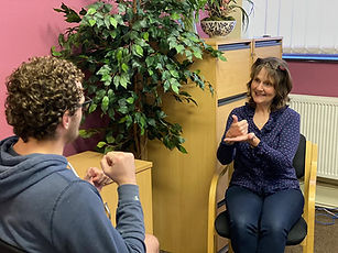 WNDA - Image of service user receiving Deaf advocacy from our BSL trained adviser