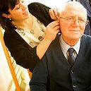 Hearing Support - Our staff member Sarah adjusting the hearing aids of a service user