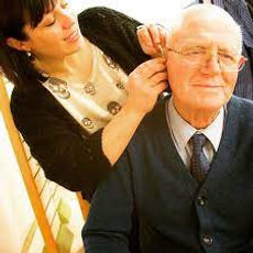 Hearing Support - Image of hearing aids being fitted