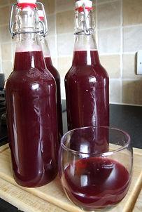Bottled blackberry and apple soda