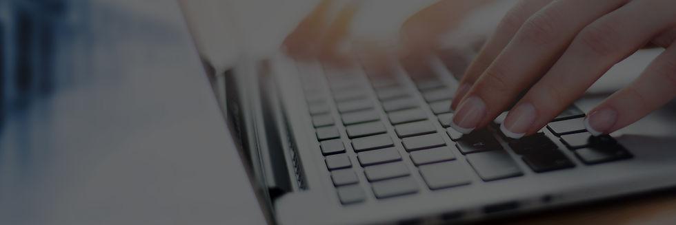 fingers typing on laptop keypad