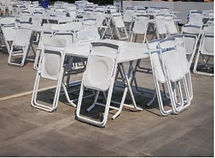 White Tables and Foldable Chairs