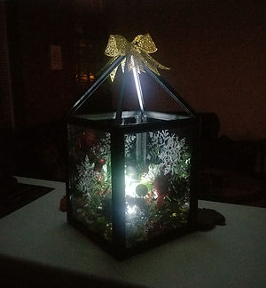 custom designed Christmas decorated lantern; gold bows, snowflakes, candles, LED lights, wreathes