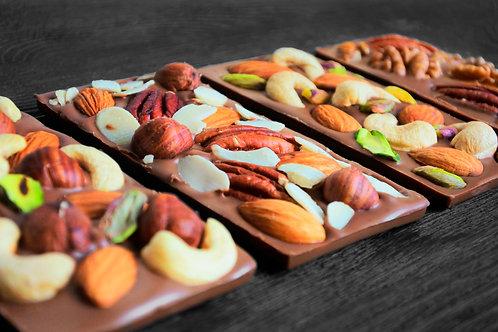 Молочный бельгийский шоколад с орехами на выбор