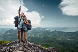 Two hikers taking selfie on top of the mountain.jpg