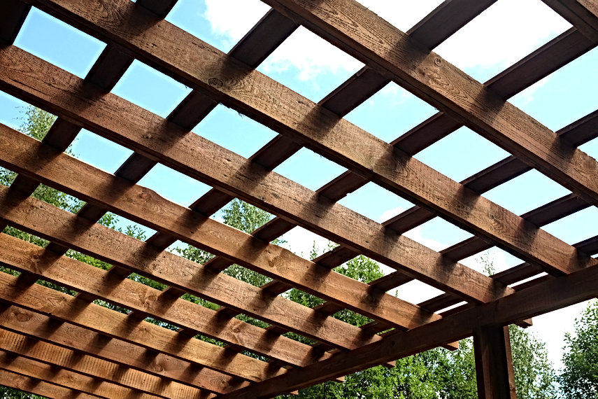Top of brown wooden pergola on sunny sum