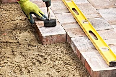 Installing paver bricks on patio, mallet