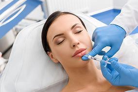 Calm girl getting cosmetic procedure.jpg