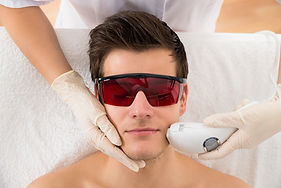 Close-up Of Beautician Giving Laser Epil