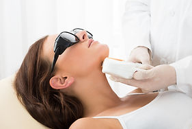Close-up Of A Therapist Giving Laser Epi
