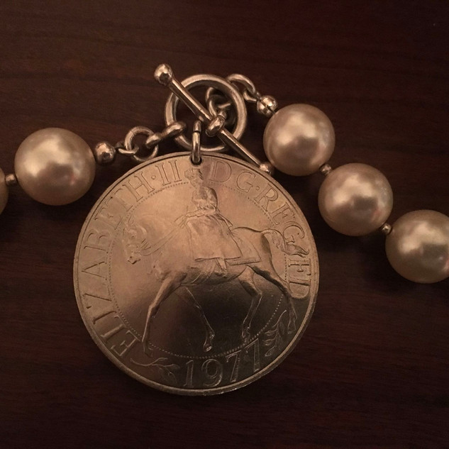 Side Saddle necklace with 1977 Queen Elizabeth II Silver Jubilee Crown Commemorative Coin and pearls. Acquiredat TheUpperville Horse Show several years ago as a present for herself.