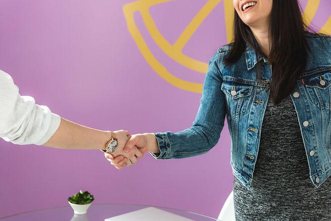 business-woman-shakes-hand.jpg