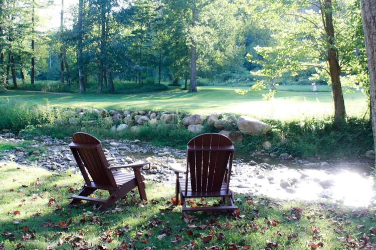chairs by river w golfer.JPG