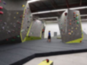 bouldering gym with people climbing