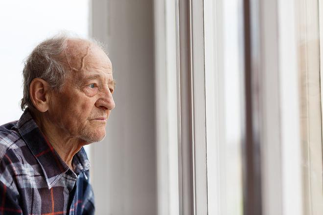 Portrait of Elderly man looking out wind