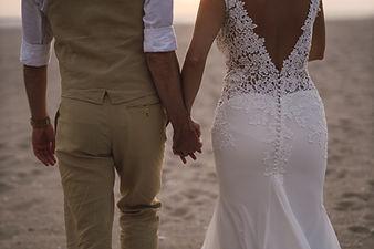 horizontal-shot-of-bride-and-broom-holdi