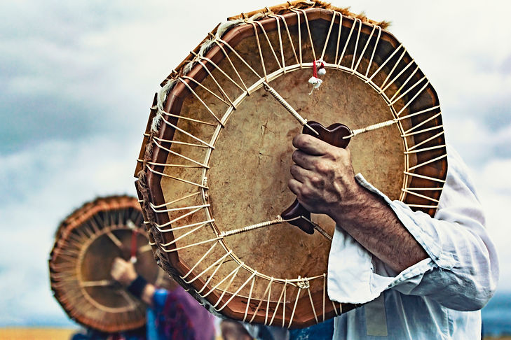 Shamanic drums in shamans hands. Ritual.