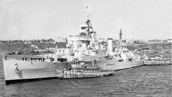 HMS SUPERB, turning to dock at pier 92, New York, September 1953.jpg