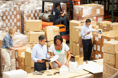 Workers preparing shipments for customers
