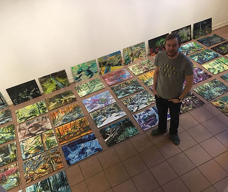 Jarkko Rantanen front of his paintings at Poriginal Gallery.