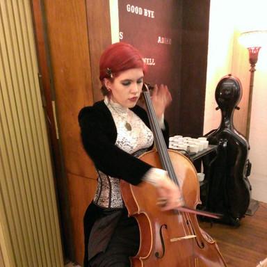 Performing at a Hoofprint Art Gallery opening.