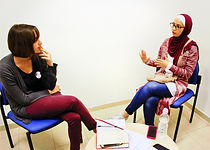 A volunteer teach conversational skills at the Hebrew University in Jerusalem
