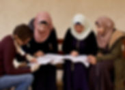 Volunteer using Lissan spacial Hebrew book to teach spoken Hewbrew in Jerusaelm Arab women who want to find a job in Jerusalem