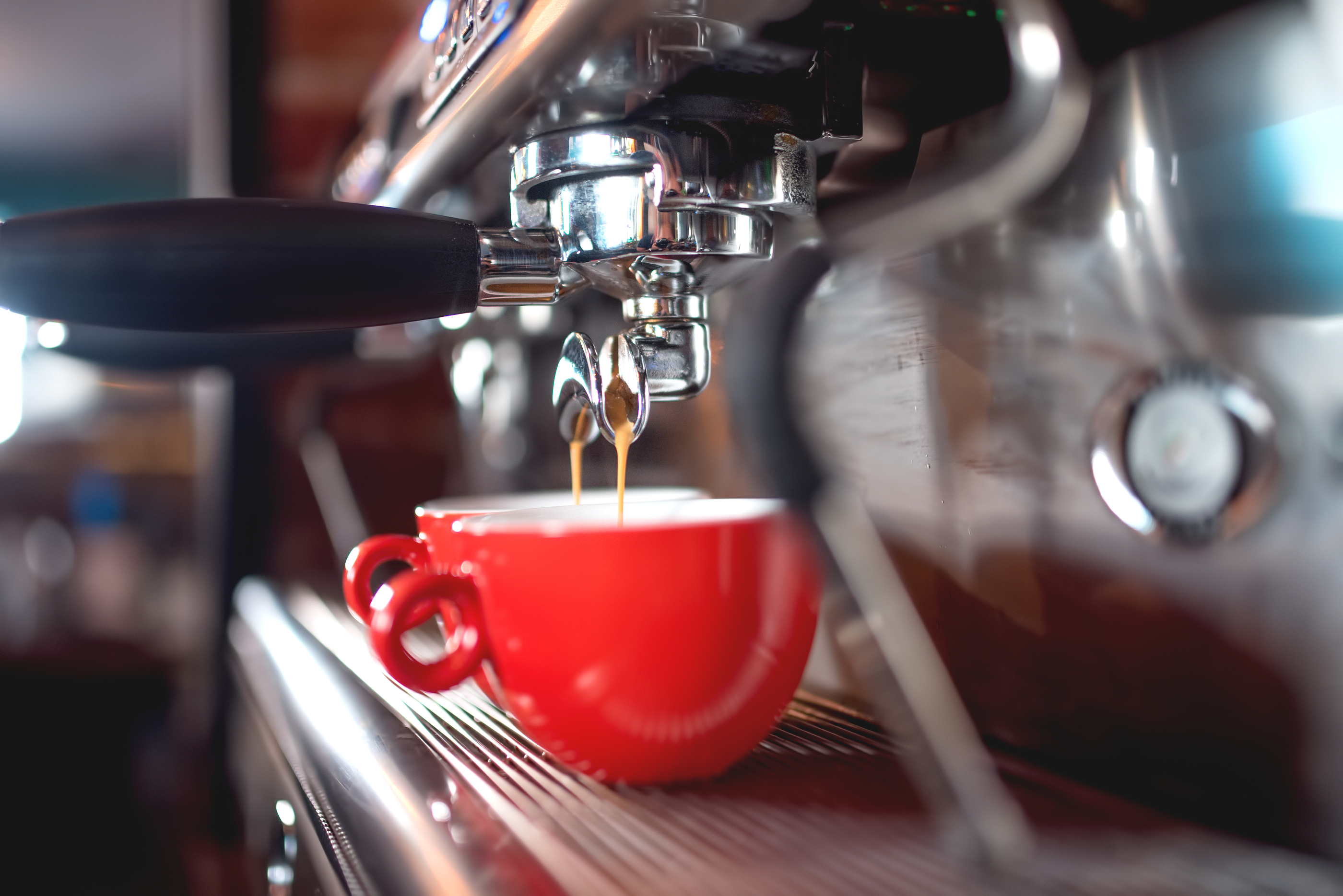 Automatic Espresso Machine Pouring Coffee In Cups At Restaurant Or Pub. Barista Concept With Machine
