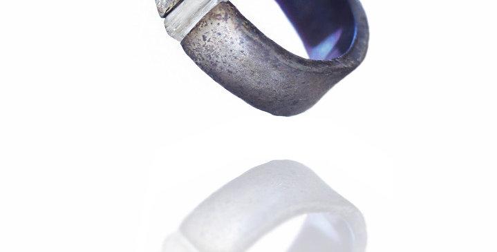 Titanium ring with unpolished tourmaline