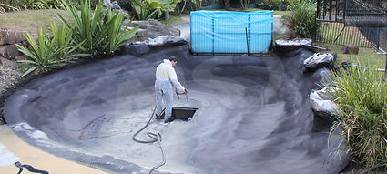 Sparying a pond with Liquid Rubber